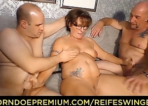 REIFE SWINGER - Obese German granny sucks with the addition of fucks duo cocks here mischievous distressing threesome
